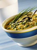 Barley soup with peas, garlic and chives