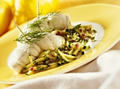 Plaice rolls on a bed of courgettes