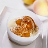 Poached peach in white wine sauce with cinnamon