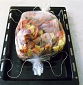 Meat and vegetables (ready to cook) in roasting sleeve