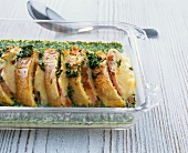 Savoury bread pudding with baguette, turkey, cheese, parsley