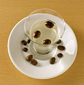 Sambuca (aniseed liqueur from Sicily) with coffee beans
