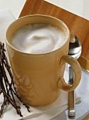 Melange (half coffee, half milk) in yellow cup