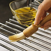 Brushing grill rack with oil