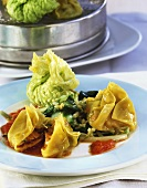 Pasta parcels and savoy parcels with tomato sauce