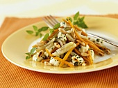 Kohlrabi and carrots with mozzarella and pine nuts