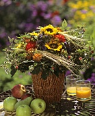 Colourful autumnal bouquet of sunflowers and cereals