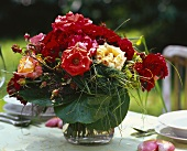 Rustic bouquet of roses on laid table