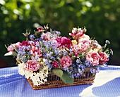 Silk flower arrangement in basket