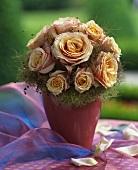 Arrangement of pastel-coloured roses