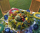 Laid table with vegetables and flower wreath