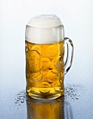 A tankard of beer with head of foam