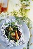 Spring vegetables steamed in aluminium foil