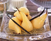 Poached pears in syrup with vanilla pods