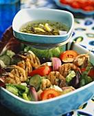 Grilled shrimp kebabs on Greek salad