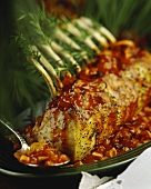 Rack of pork with rosemary and tomato sauce