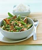 Chicken jalfrezi (spicy chicken ragout with peas, India)