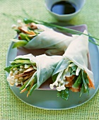 Rice paper bags filled with chicken and Asian vegetables
