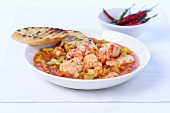 Fish and shrimp stew and toasted baguette slices