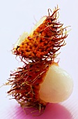 A rambutan with opened skin