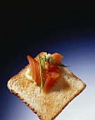 Slice of toast with smoked salmon and salmon caviare
