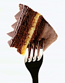 A piece of lemon chocolate cake on a fork