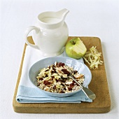 Muesli with grated apple, dried cherries and almonds