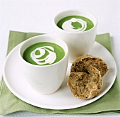 Pea soup with crème fraiche in beakers; wholemeal roll
