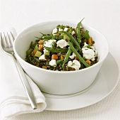 Green bean and lentil salad with vegetables and feta