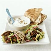 Lamb kebab with pita bread and yoghurt