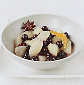 Pear and blueberry compote in small bowl