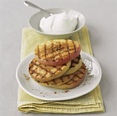 Grilled apple slices with a small bowl of quark