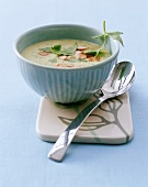 Potato soup with parsley and flaked almonds in small bowl