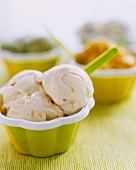 Orange and honey ice cream with raisins in a small bowl