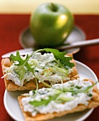 Crispbread topped with quark and rocket and an apple