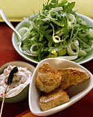 Three pork fillets with pepper dip and rocket and celery salad