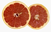 Two red grapefruit halves
