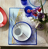 Single place setting on a table mat