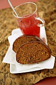 Two pieces of spiced cake with fruit tea