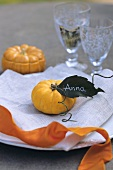 A table decorated with pumpkins