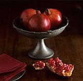 Three pomegranates in a bowl