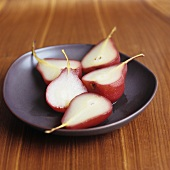 Five pear halves poached in red wine