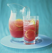 Watermelon drinks with ice cubes and slices of lime