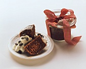 Chocolate nut cakes on a plate and in jar as a gift