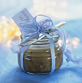 Pork lard in a jar with a bow