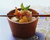 Spiny lobster in almond tempura over polenta soup
