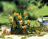 Arrangement of blood flowers (Asclepias curassavica) & roses