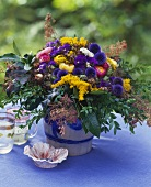 Summer flowers: globe thistles, golden rod, straw flowers