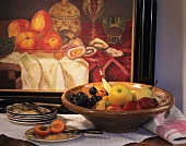 Still life with fruit bowl and painting