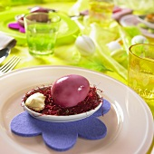 Purple marbled Easter egg in a bowl of mayonnaise